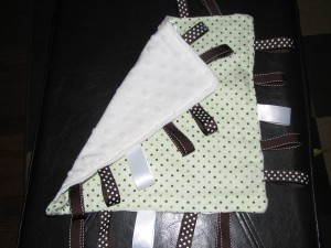 Showing the other side made of Minky dot fabric