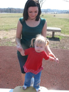 My sister hold my daughter - she really wanted to stand in the middle of the teeter totter