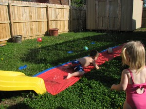 We moved the slip n slide to the end of our slide - fun!